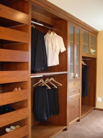 Custom cabinetry and accessories made the most of clothes and bedding storage.