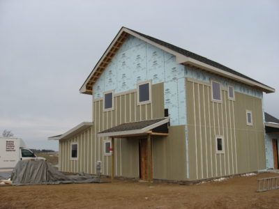 The farm-style house getting its board-and-batten siding