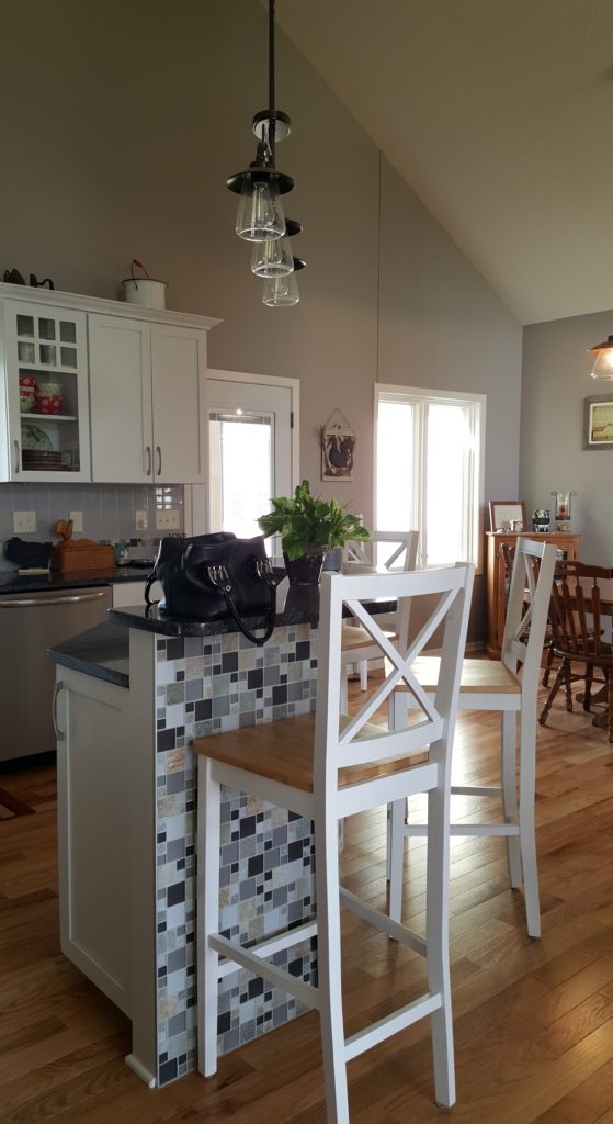 The neutral warm gray walls provide a backdrop for cabinets, tile and floors