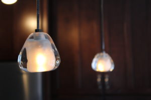 The peninsula pendants look like melting ice and can be dimmed for different lighting needs.