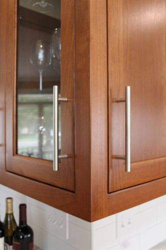 High-skilled cabinetry work includes the inset doors, beautiful stained finish, and details such as this display cabinet that opens on both sides.