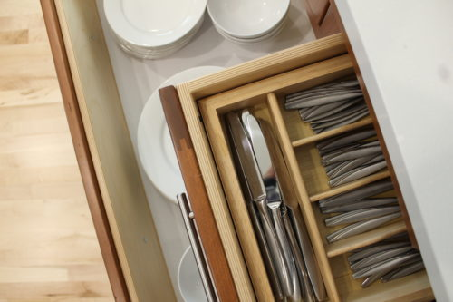 Drawer and cabinet accessories make setting a table and unloading the dishwasher easy for the family and guests who want to help.