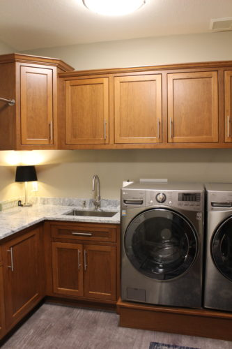 The existing laundry was reworked to include a large closet, bench/coat storage and a beautiful area for storage and clothes care.