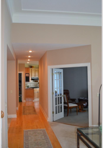 Before: an angled-entry TV room separated the kitchen and living room, and made the hallway between dark.