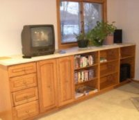 Stock cabinetry provides closed-door storage for sewing supplies