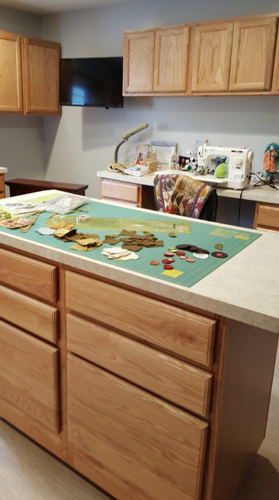 This sewing room makes use of an unfinished basement.