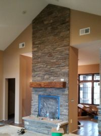 The fireplace intersects the tallest ceilings in the main part of the house