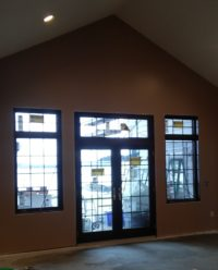 French doors open to the roofed lanai and out to the lake