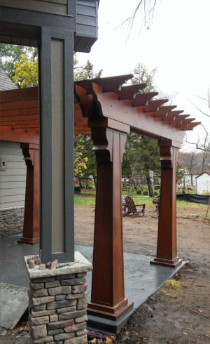 The pergola shelters a patio just for the master bedroom