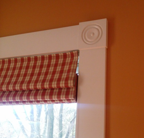 White trim really stands out against an orange wall