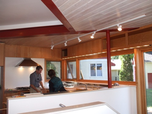 Exposed steel, wood deck and quarter-sawn cabinetry
